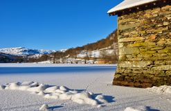 Boathouse on frozen Rydal Water Stock Photo