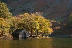 Boathouse In Autumn Colours Royalty Free Stock Photos