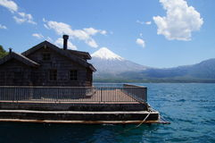 Boathouse in Lagos todos los santos - Chile. Fisherman boat house in the lago todos los santos, at petrohue, chile, with the osorno vulcan at the background stock images