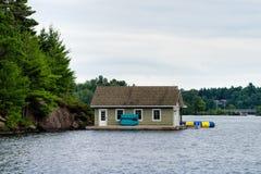 Boathouse on a lake Stock Photo