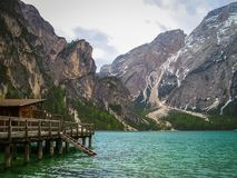 Boathouse at Lake Braies, Lago di Braies in the Dolomites, Italy in spring royalty free stock image