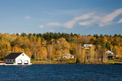Boathouse on lake in fall Royalty Free Stock Photos