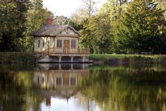 Boathouse at a lakeside in Autumn Stock Images