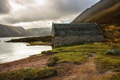 Boathouse at Loch Muick. Cairngorms National Park, Scotland, UK. stock photo