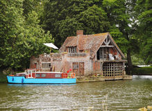 Boathouse and Moorings on the River Thames Royalty Free Stock Photos