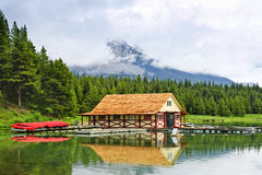 Boathouse on mountain lake. Canoes at boathouse on Maligne Lake in Jasper National Park, Canada Stock Photos