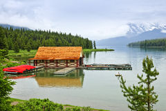 Boathouse on mountain lake. Canoes at boathouse on Maligne Lake in Jasper National Park, Canada Royalty Free Stock Photography