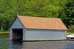 Boathouse with open door Stock Photos