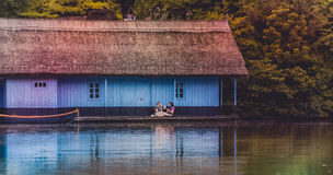 Boathouse with people Royalty Free Stock Photography