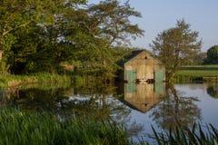 Boathouse with reflection Stock Photos