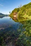 Boathouse reflections at lake. royalty free stock image