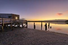 Boathouse on the shores of Okarito Lake Royalty Free Stock Photography