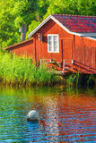 Boathouse during summer. Idyllic boathouse during summer in sweden Royalty Free Stock Photo
