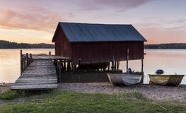 Boathouse in sunset. Idyllic Boathouse in beautiful afterglow Royalty Free Stock Images