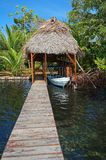 A boathouse with thatched palm roof Stock Photo
