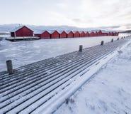 Boathouses και μια παγωμένη λίμνη Στοκ Φωτογραφίες