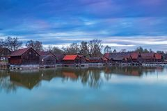 Boathouses at daybreak, Lake Ammersee. Boathouses at daybreak in Diessen, Lake Ammersee, Bavaria, Germany Royalty Free Stock Photography