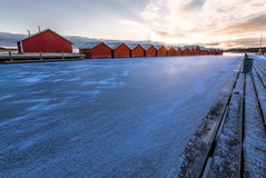Boathouses and a frozen lake Stock Photo