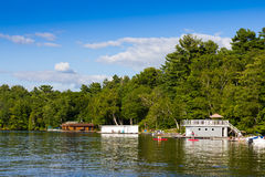 Boathouses on a lake Royalty Free Stock Images