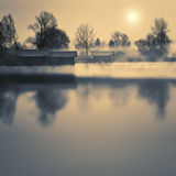 Boathouses on a lake in winter Stock Image