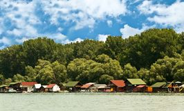 Boathouses on river Stock Photo