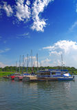 Boating. Boats anchored at a dock Stock Images