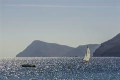 Boating, Agua Amarga, Cabo de Gata. A small yacht on the Mediterranean Sea off the coast of Agua Amarga in the Cabo de Gata Natural Park, Andalucia, Spain Stock Photo