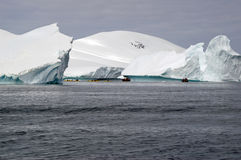 Boating among Antarctic icebergs Royalty Free Stock Images