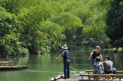 Boating in bamboo forest and lake. The relaxed people was fishing and boating on the lake and bamboo forest which in ChangNing County of Sichuan province,China Royalty Free Stock Photo