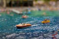 Boating on the beach. People drive a boat in the summer beach miniature Royalty Free Stock Photo