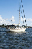 Boating on Blue Water. Sail boat touring the Gulf of Mexico on a beautiful summer day Royalty Free Stock Photo