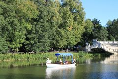 Boating on a bright Sunny day on the pond stock photography