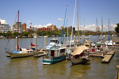 Boating in the city. Picture of boats in the river with backdrop of buildings Stock Images