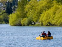 Boating Couple. A couple in a paddle boat in a lake Royalty Free Stock Photos