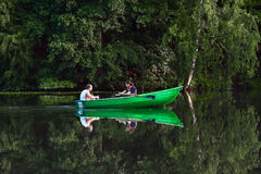 Boating. Couple boating on the pond royalty free stock photo