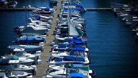 Boating dock. One of the luxurious ways of spending their vacations Stock Photography