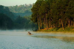 Boating in fog. Early morning sunrise, boating on the lake in a huge fog Stock Photo
