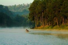 Boating in fog Stock Photo