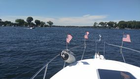 Boating on fourth of July. Boating on lake on the fourth of July on Lake Minnetonka royalty free stock images