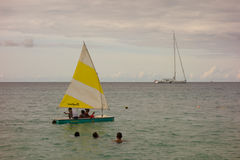 Boating fun in the windward islands on a sunday Royalty Free Stock Photo