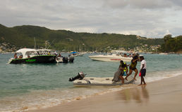 Boating fun in the windward islands on a sunday Royalty Free Stock Images