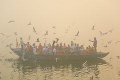 Boating on Ganges River with dense fog Stock Photo