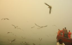 Boating on Ganges River with dense fog Stock Photos