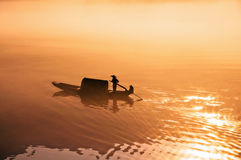 Boating in golden sunshine  Royalty Free Stock Images