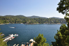 Boating on Lake Arrowhead. A speed boat makes its way across Lake Arrowhead in the San Bernardino mountains Stock Image