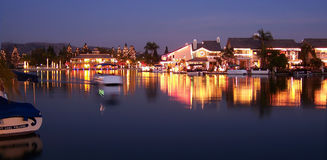Boating on Lake with Christmas Lights. Boating on a lake with Christmas lights reflecting on the water Stock Photos