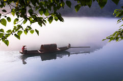 Boating in the lake full of fog Royalty Free Stock Photo