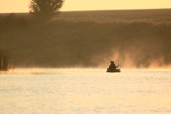Boating on the lake in a huge fog Stock Photography