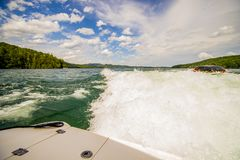 Boating on a lake in the mountains Stock Photography