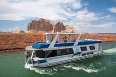 Boating on Lake Powell, Arizona. Exploring  Lake Powell by House Boat in Arizona, USA Royalty Free Stock Images